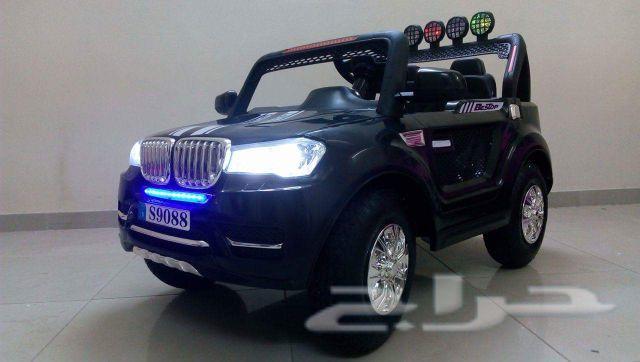 سيارة أطفال BMW كفرات نفخ ودفع رباعي